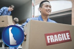 de movers unloading a moving van and carrying a fragile box