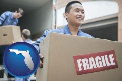 florida map icon and movers unloading a moving van and carrying a fragile box