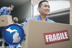 michigan map icon and movers unloading a moving van and carrying a fragile box