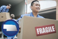 nebraska movers unloading a moving van and carrying a fragile box